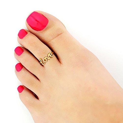 Le secret de jolis pieds? Une jolie pédicure et des bagues d'orteils!