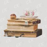 Un tas de livres et une tasse de thé